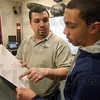 Measure Twice: Marquis Songer works with student Anthony Long during class Wednesaday afternoon.