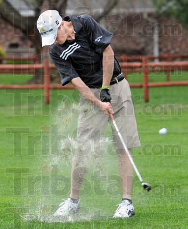 Water hazard: Northview's #1 player, Larry Knight blasts his ball out of the water covered fairway on the sixth hole at Forest Park Saturday afternoon.