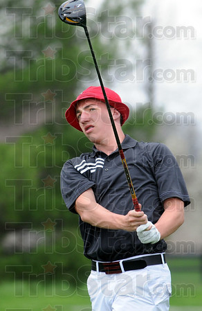 Slammin' Sam : Terre Haute South's Sam Harbaugh, playing in the number four position hits a shot to the green during match action Saturday.