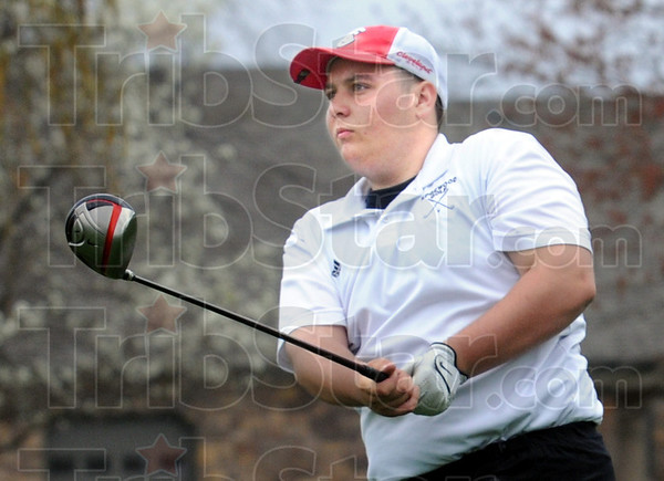 Flight: Edgewood's Jackson Cowden watches the flight of his ball during match action at Forest Park Saturday afternoon.