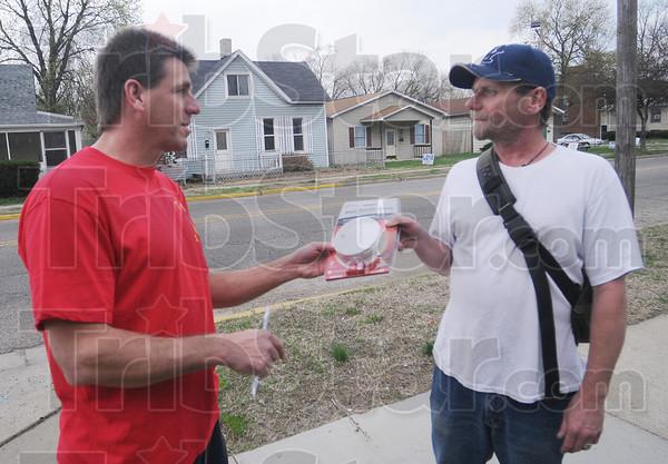Tribune-Star/Rachel Keyes<br /> Detection: Terre Haute Firefighter Jeff Hodges (left) hands out a smoke detector to Terre Haute resident James Allison.