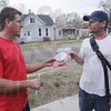 Tribune-Star/Rachel Keyes<br /> Detection: Terre Haute Firefighter Jeff Hodges (left) hands out a smoke detector to Terre Haute resident James Allison.
