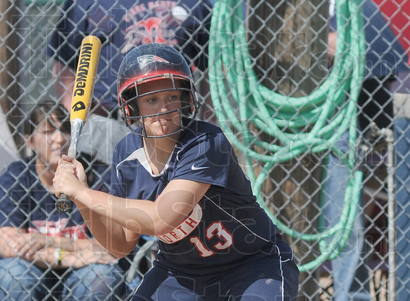 Tribune-Star/Rachel Keyes<br /> Batter up: Terre Haute North's Hailee Travioli step up to the plate in action Saturday.