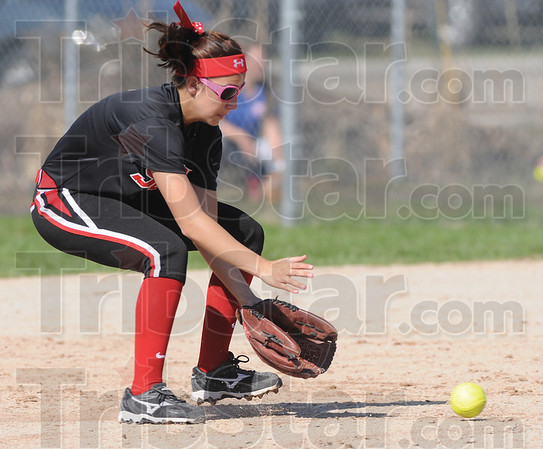 Tribune-Star/Rachel Keyes<br /> Scoop it up: Terre Haute South Junior Jena Renteria scoops up the ball  at shortstop for a stop against Henderson Saturday.