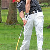 Contact: Terre Haute South's #1 plalyer Thomas Goss makes contact on the sixth hole tee during Saturday's match action at Forest Park.