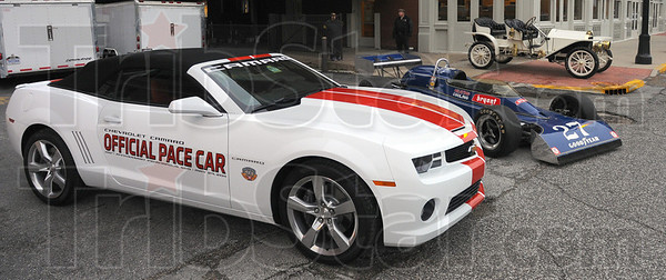 Tribune-Star/Jim Avelis<br /> On display: Out for viewing Saturday morningl at the Indy 500 100th anniversary kickoff were three cars. The Chevrolet Camaro is this years' pace car. Behind it is Janet Guthrie's race car fron the mid-1970's. Behind them is a 1911 racer.