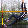 Tribune-Star/Jim Avelis<br /> Over easy: Christie Hasbrouck clears an early height in the pole vault at the Patriot Invitational Saturday morning.