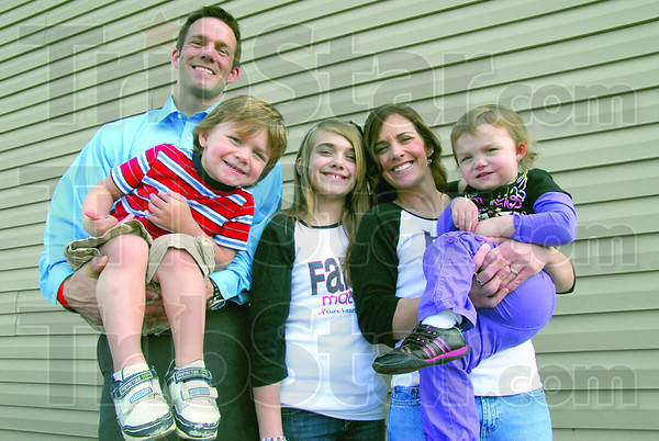 Family: Members of the Halon family pose for a photo on April 8 at their Avon home.  Josh holds son Owen, daughter Jacey, 10, stands by Becky, who is holding Norah, 2.