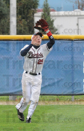 Tribune-Star/Rachel Keyes<br /> In the glove: Terre Haute North's Tony Rosselli catches one for an out in action Saturday against Warren Central.