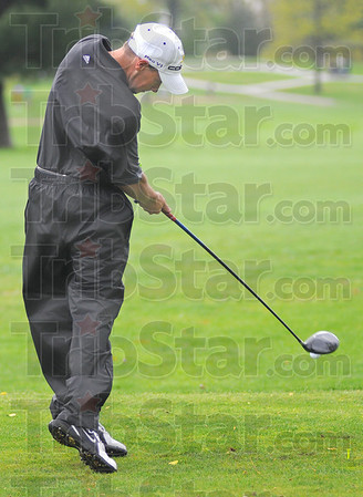 Tribune-Star/Jim Avelis<br /> Tee time: Northview golfer Larry Knight tees off on the front nine at Rea PArk Saturday morning.