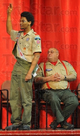 Tribune-Star/Jim Avelis<br /> I promise: David English takes the oath at his Eagle Scout ceremony Saturday. His Big Brother Dan Snider listens and watches.