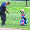 Tribune-Star/Jim Avelis<br /> Chipper: Patriot golfer Ryan Sneddon chips to the green early in his round at the Braves Invitational golf match.