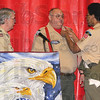 "Tribune-Star/Jim Avelis<br /> Honored: Dan Snider, center, receives the ""Eagle Scout Dad"" pin from David English at a ceremony honoring English for achieving the level of eagle Scout Saturday. Jim Edwards of Ryves Hall watches."