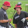 Tribune-Star/Jim Avelis<br /> Always looking: Brave golfers Thomas Goss and Shelby Stewart look over Northview golfer Jacob Musgraves' driver as they wait for the fairway to clear during the Braves' Invitational golf meet.