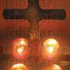 Tribune-Star/Rachel Keyes<br /> Glowing prayers: Candles lit at the Last Supper Mass held Thursday evening at St. Joseph University parish.