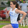 Tribune-Star/Jim Avelis<br /> 400: Kaci Smith rounds the first turn in the 400 meter dash Saturday at the Pacesetter Invitational.