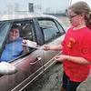 Tribune-Star/Rachel Keyes<br /> Smoke detection: Nancy Huffington receives a free smoke detector from Izabella Drake as part of the Protect the Precious campaign. A campaign hosted by the Terre Haute Fire Department.