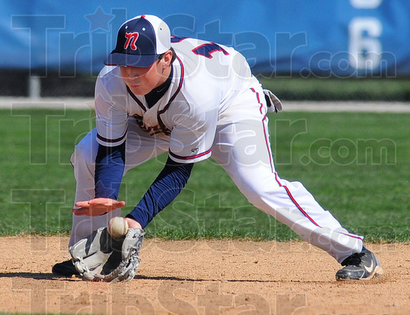 Tribune-Star/Jim Avelis<br /> Stopper: Shortstop Cody Gardner gloves a groundball early in the Patriots' game with Ben Davis Saturday morning.