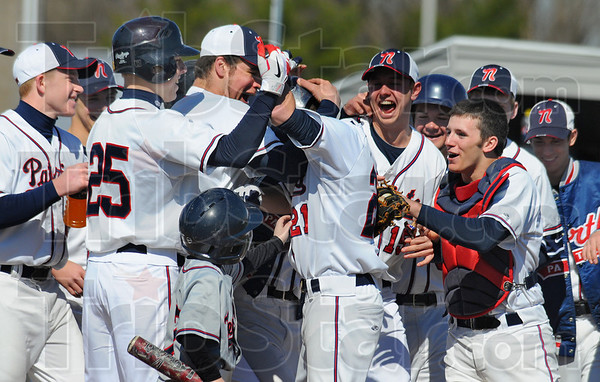 Tribune-Star/Jim Avelis<br /> Mobbed: Dalton Hathaway, center, is mobbed by teammates as he crosses home plate folowing a solo homerun against Ben Davis Saturday morning.