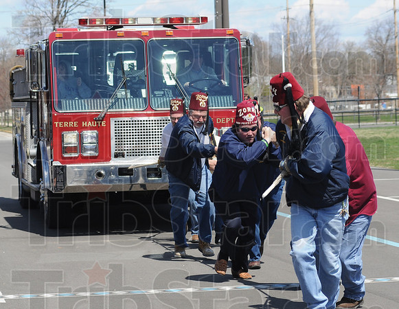 Tribune-Star/Rachel Keyes<br /> Heave ho: The Zorah Shrines give it a good effort in the Pike Fire Truck Pull Saturday afternoon proceeds from the event benefit the Special Olympics.