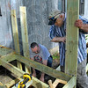 SAWS: Brent Jones and Tom Booker work installing a wheelchair ramp for James Shafer Wednesday morning on the City's northside.
