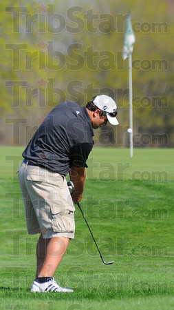Tribune-Star/Jim Avelis<br /> Long green: Jacob Musgrave, Knights #2 golfer Wednesday, chips to the first green.