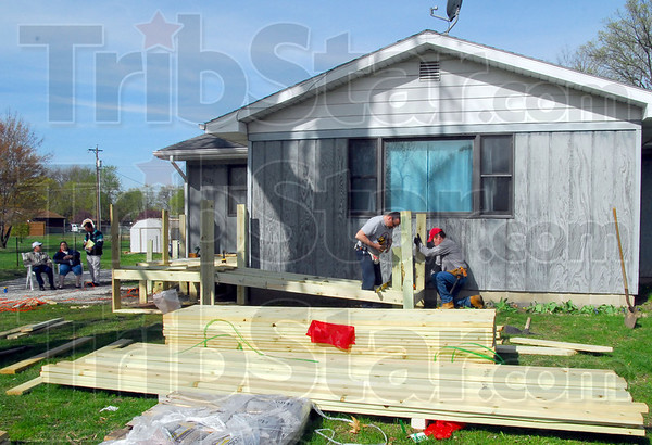 Ramp: SAWs workers install a wheelchair ramp at James Shafer's northside home Wednesday morning.