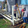 Construction: Brent Jones and John Anderson work installing a ramp at James Shafer's northside home Wednesday.