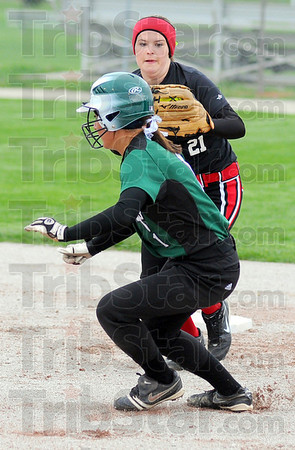Tribune-Star/Jim Avelis<br /> Caught in the act: West Vigo baserunner Alicyn Woorward is caught in a rundown by Brave second baseman Marissa Stout.