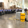 Tribune-Star/Jim Avelis<br /> Special guest: U.S. Senator Dan Coats, right addresses employees of Clabber Girl Wednesday afternoon after a tour of their manufacturing facility on North ninth street.