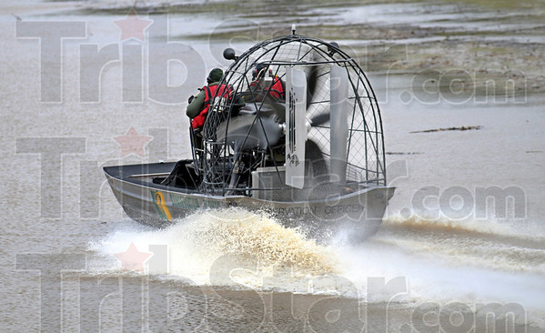 Air boat: Indiana Conservation officers Lt. Kent Hutchin and  Chris Springstun search the waters of Big Walnut Creek in Putnam County Wednesday morning.