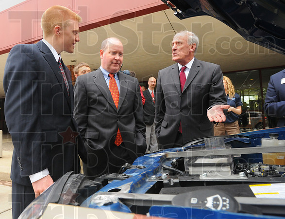 Tribune-Star/Jim Avelis<br /> Tech update: Rose-Hulman Mechanical Engineering student Chad Conway talks with Congressman Larry Buschon and U.S. Senator Dan Coats about the schools' Ecocar program. The junior is a member of the Ecocar challenge team.