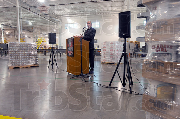 Tribune-Star/Jim Avelis<br /> Rising to the occasion: U.S. Senator Dan Coats had a tour of the Clabber Girl manufacturing facility on north ninth street Wednesday.