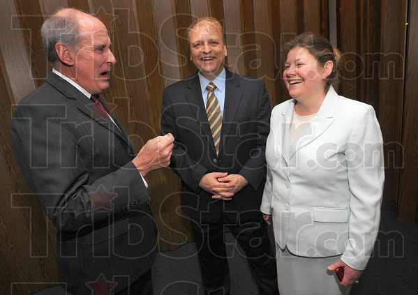 Tribune-Star/Jim Avelis<br /> Good times: U.S.senator Dan Coats shares a laugh with Vigo County Republican Party chairman and his wife, Bill and Angela Treadway before the Lincoln Day dinner Wednesday evening.