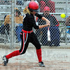 Tribune-Star/Jim Avelis<br /> Long ball: Kelsey Marlow raps out a hit in the Braves' game with West Vigo Wednesday evening.