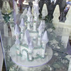 Ornate stuff: Reflections of people lined up outside Carlo's City Hall Bake Shop can be seen on the storefront display case, where a castle-style cake sites. Tribune-Star/Mark Bennett