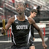 Lead off: Terre Haute South's Dale Young runs a 2:08 leg of the 3200 meter relay during Wednesday's track meet.