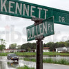 High water: Water flows across Cullen Place near Kennett Drive Wednesday afternoon.