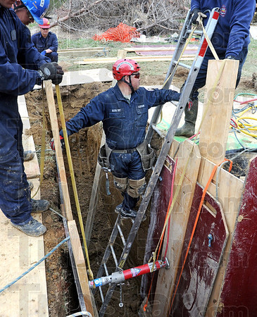 Trench talk: Sugar Creek firefighter Hidekatsu Kajitani works in a trench during a training exercise Wednesday morning.