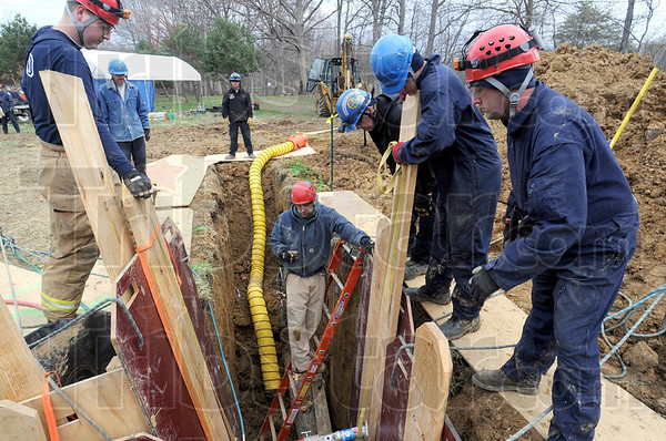 Trench training: Firefighter Jason Kane works in the trench Wednesday morning as part of a training exercise for Sugar Creek, Otter Creek, Honey Creek and Terre Haute City fire departments.