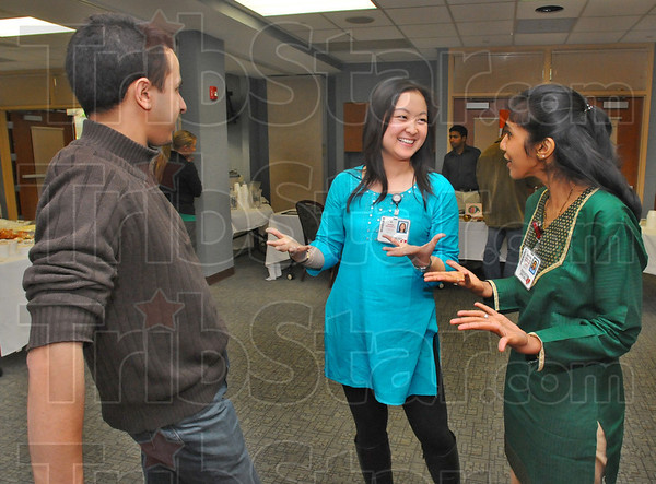 Tribune-Star/Jim Avelis<br /> Multicultural: Morrocan Wassim Zhani, an ISU student,  chats with Union hospital employees Yi Chew and Muthu Sadayappan. The three were at Union Hospitals' Diversity Fair.
