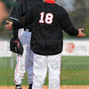 Tribune-Star/Jim Avelis<br /> Settle down: Brave pitcher Brent Mulvihill listens to coach Kyle Kraemer after giving up a first inning homerun.