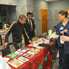 Tribune-Star/Jim Avelis<br /> Getting to know you: Saudi Arabian students Naif Almatrafi and Majed Alghurairi talk with Union Hoispital nurses Betsie Jackson and Lori Athey during the hospitals' Diversity fair Wednesday afternoon.
