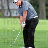 Chip: West Vigo's Brandon Blystone chips to the green during early action against Cloverdale's Chris Arnold.