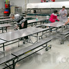 Cafeteria: Staff and students clean the tables in the Fuqua Elementary School cafeteria Monday afternoon after serving several hundred meals.