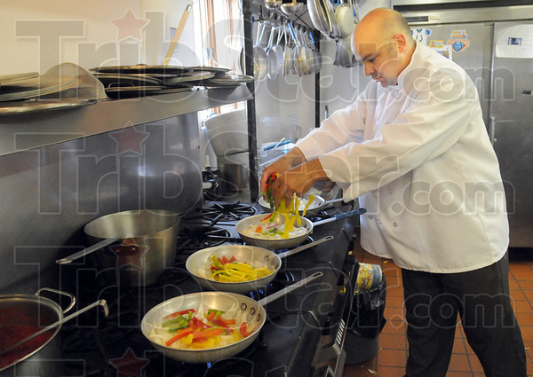 Ingredients: Pino's Chef Pedro Piloni prepares a CHIP meal Monday evening.