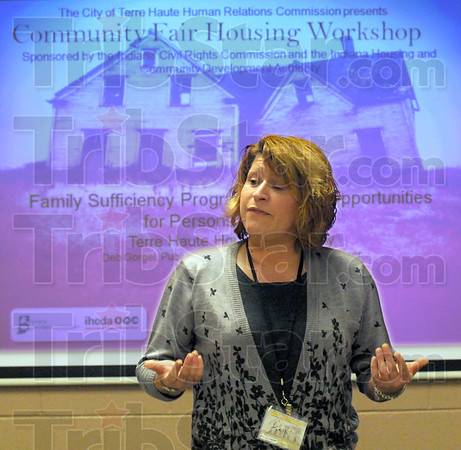 Workshop: Terre Haute Housing Authority representative Kelli Fuller gives a presentation during Monday's Community Fair Housing Workshop at the Booker T. Washington Center.