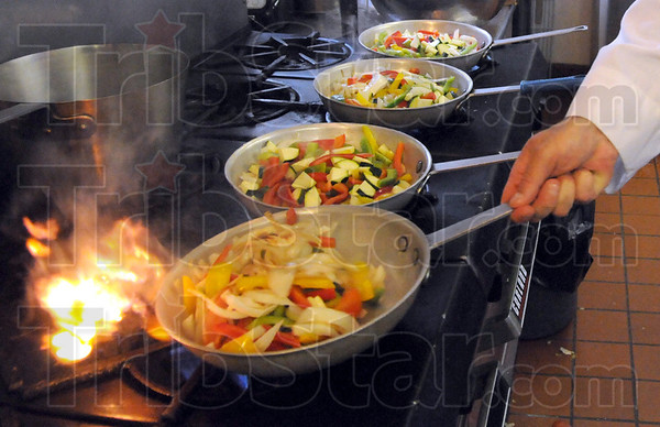 Prep: Pino's Chef Pedro Piloni prepares food for the Coronary Health Improvement Project Monday night.