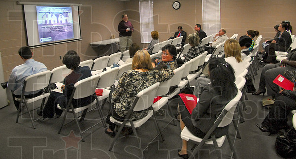 Housing: Deb Gorgol leads a discussion group at the Booker T. Washington Center on fair housing Monday morning.