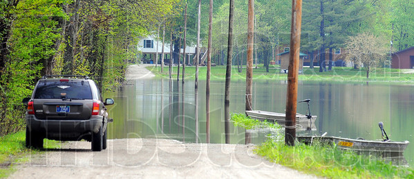 Park and float: Residents of Oakley Park on the Wabash River north of West Terre Haute are used to the river covering Fairview Avenue. Jonboats ferry them to and from their vehicles parked near Barnhardt Road. Tribune-Star/Jim Avelis